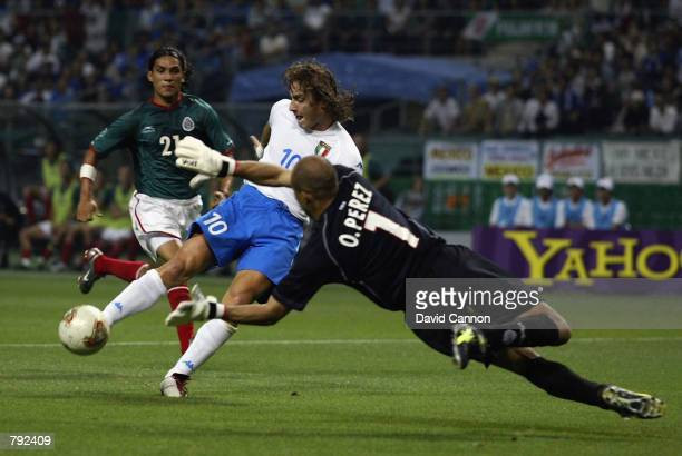 Oscar Perez of Mexico dives to save a shot from Francesco Totti of Italy during the FIFA World Cup Finals 2002 Group G match played at the Oita Big...