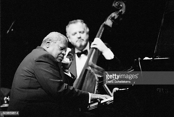 Oscar Peterson, piano, performs with Nils Henning Osted Pederson, bass, on July 14th 1995 at the North Sea Jazz Festival in the Hague, the...