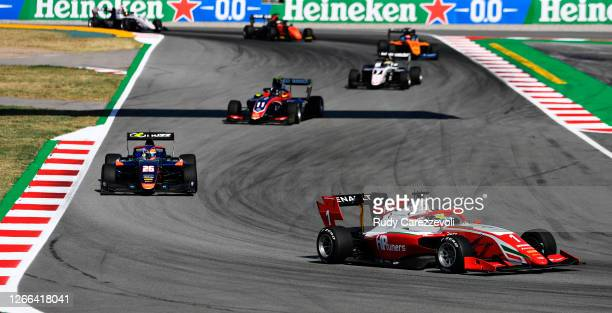 Oscar Piastri of Australia and Prema Racing leads Clement Novalak of Great Britain and Carlin Buzz Racing during race one of the Formula 3...