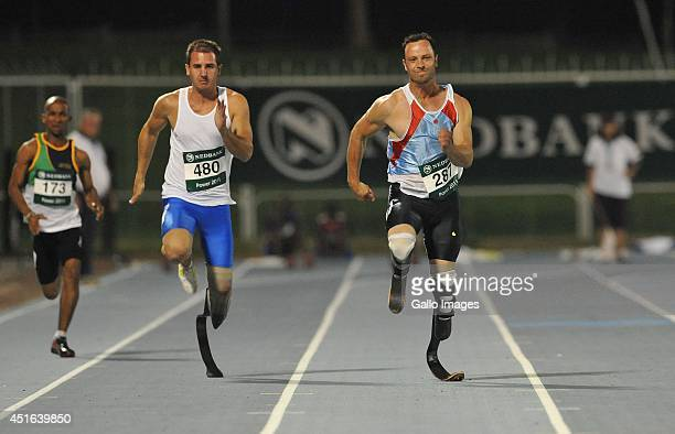 Oscar Pistorius and Arnu Fourie during the 100m on day 3 of The Nedbank National Championships for the Physically Disabled from Olympia Park Stadium...