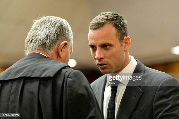 Oscar Pistorius and Barry Roux at the Pretoria High Court on March 3 in Pretoria, South Africa. Pistorius, stands accused of the murder of his...