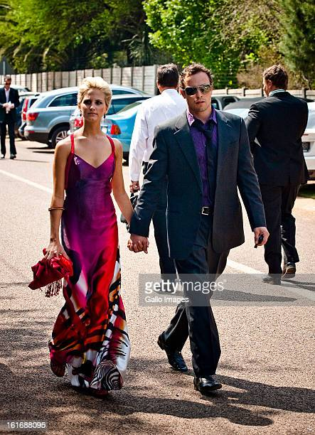 Oscar Pistorius and girlfriend Melissa Rom arrive at the Sorex Estate for the wedding of Bryan Habana and Janine Viljoen on September 19 2009 in...