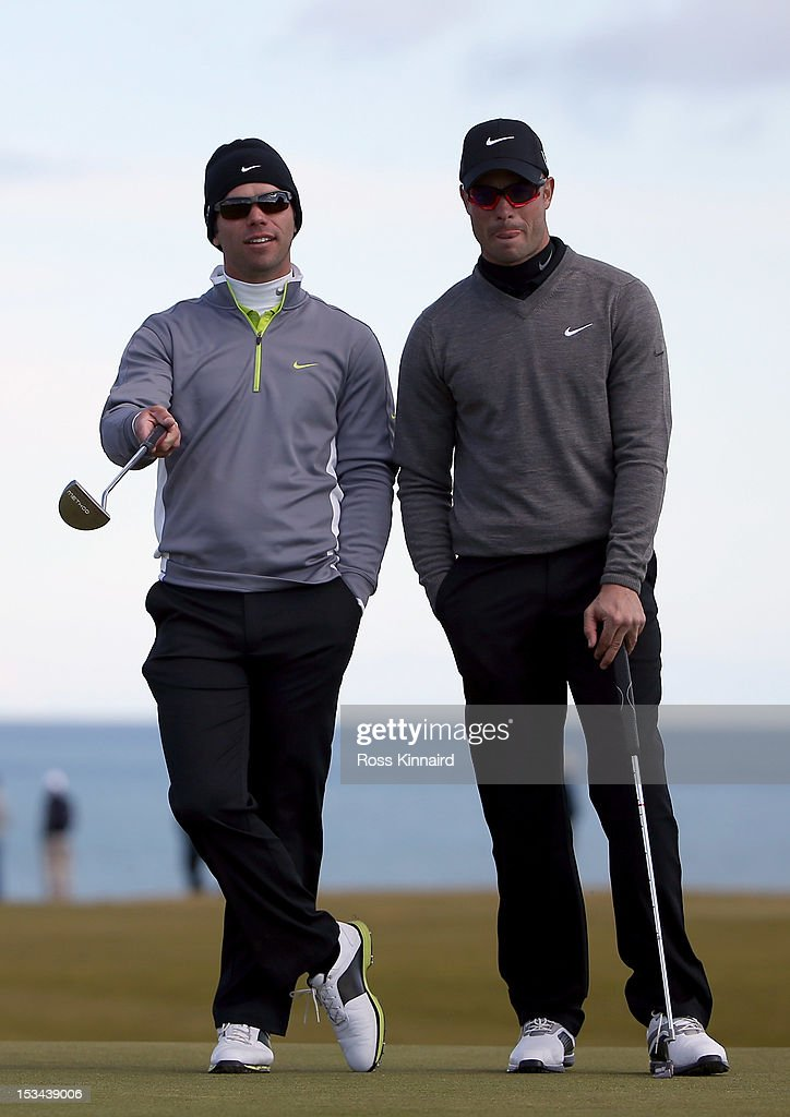 Oscar Pistorius and Paul Casey of England on the nineth green during the second round of The Alfred Dunhill Links Championship at Kingsbarns Golf Links on October 5, 2012 in Kingsbarns, Scotland.