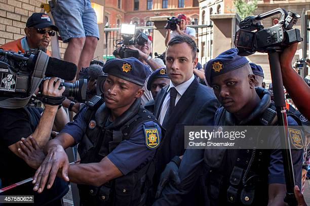 Oscar Pistorius arrives at the North Gauteng High Court for sentencing on October 21 2014 in Pretoria South Africa Pistorius will today be sentenced...