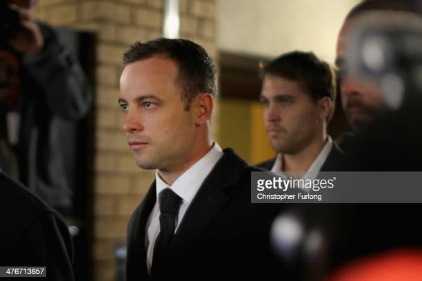 Oscar Pistorius arrives inside North Gauteng High Court for the third day of his trial accused of the murder of his girlfriend Reeva Steenkamp on...