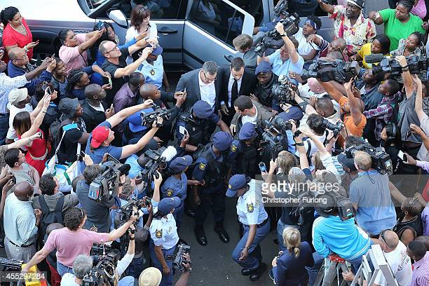 Oscar Pistorius arrives to North Gauteng High Court on September 12, 2014 in Pretoria, South Africa. South African Judge Thokosile Masipa has ruled...