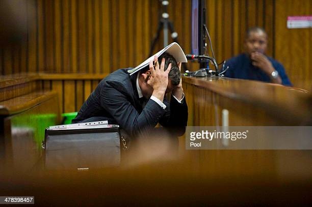 Oscar Pistorius at the Pretoria High Court on March 13 in Pretoria South Africa Pistorius stands accused of the murder of his girlfriend Reeva...