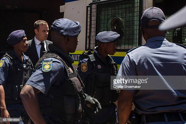 Oscar Pistorius departs the North Gauteng High Court on October 21, 2014 in Pretoria, South Africa. Pistorius has been sentenced to the maximum term...