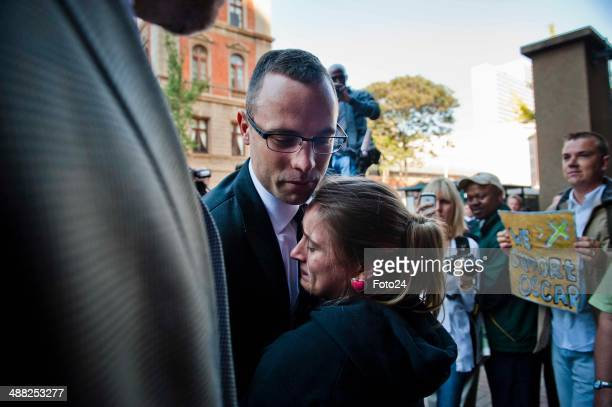 Oscar Pistorius is hugged by supporters as he arrives at the Pretoria High Court on May 5 in Pretoria, South Africa. Oscar Pistorius, stands accused...