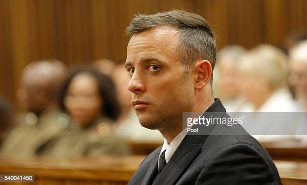 Oscar Pistorius is seen inside the dock at the high court in Pretoria for his sentencing hearing at the high court in Pretoria on June 14, 2016 in...