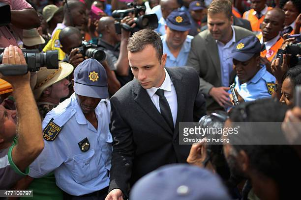 Oscar Pistorius is surrunded by police and media as he leaves North Gauteng High Court after the fifth day of his trial on March 7, 2014 in Pretoria,...