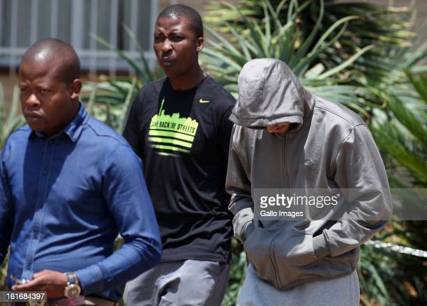 Oscar Pistorius leave Boschkop Police Station on February 14, 2013 in Pretoria, South Africa. Pistorius was then taken to hospital for a blood test,...