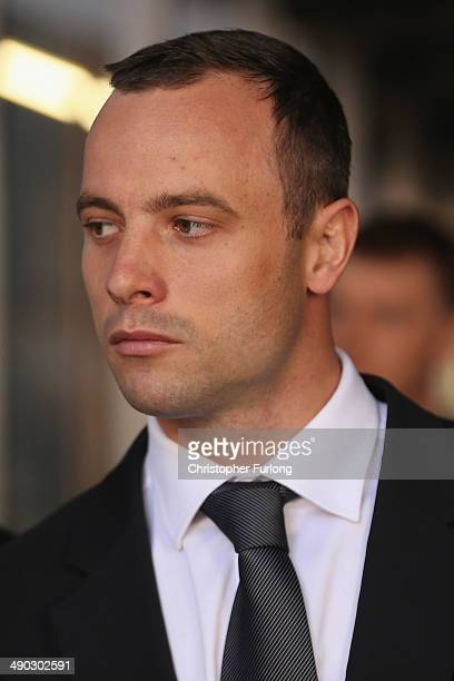Oscar Pistorius leaves North Gauteng High Court after the judge ordered that he should undergo mental evaluation on May 14, 2014 in Pretoria, South...