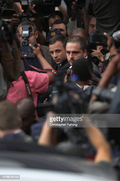 Oscar Pistorius leaves North Gauteng High Court amid a media scrum after the second day of his trial accused of the murder of his girlfriend Reeva...