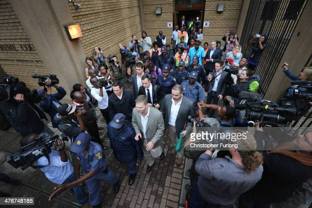 Oscar Pistorius leaves North Gauteng High Court at the end of the third day of his trial accused of the murder of his girlfriend Reeva Steenkamp on...
