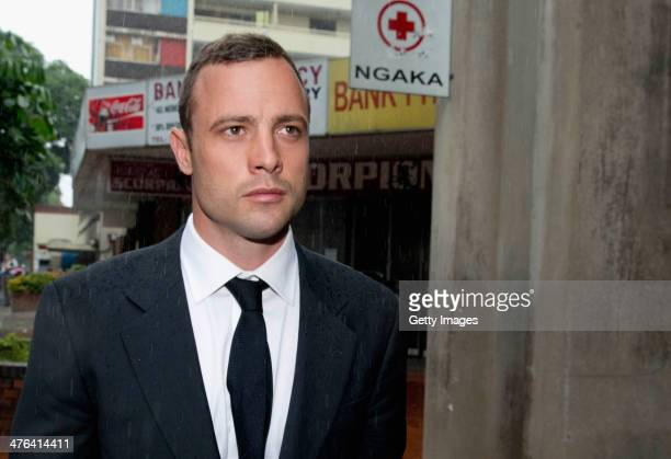 Oscar Pistorius leaves North Gauteng High Court during the lunchtime break as he faces trial accused of the murder of his girlfriend Reeva Steenkamp...