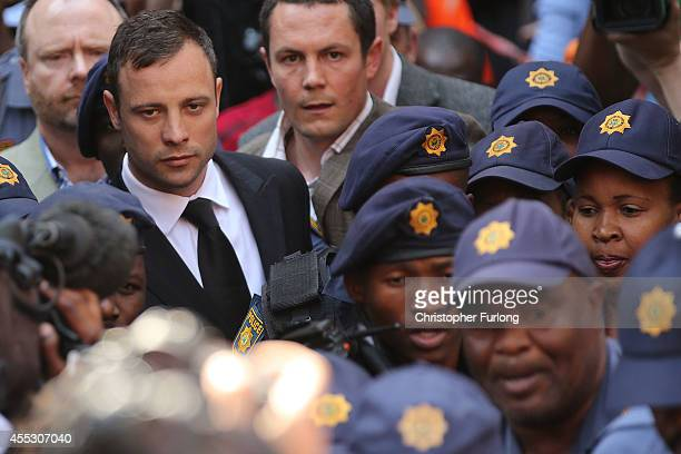 Oscar Pistorius leaves on bail from the North Gauteng High Court on September 12, 2014 in Pretoria, South Africa. South African Judge Thokosile...