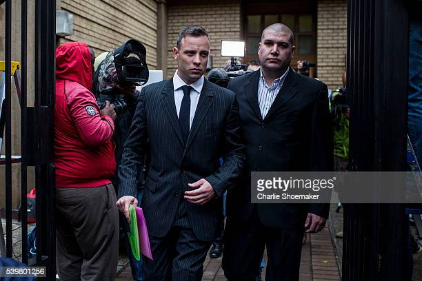 Oscar Pistorius leaves the North Gauteng High Court during a lunch break on June 13, 2016 in Pretoria, South Africa. Having had his conviction...