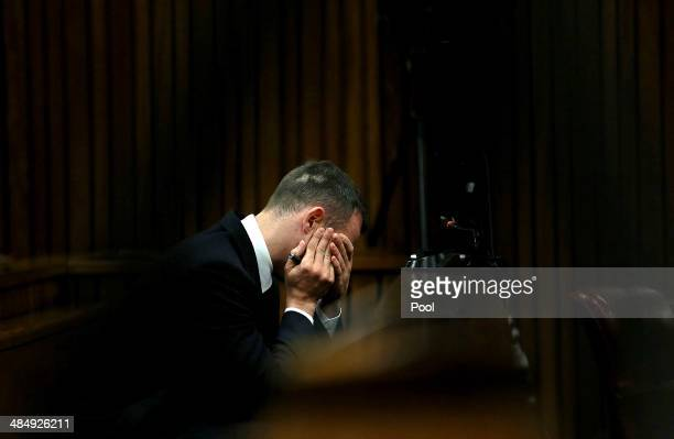 Oscar Pistorius listens to evidence in the Pretoria High Court on April 15 in Pretoria, South Africa. Oscar Pistorius stands accused of the murder of...