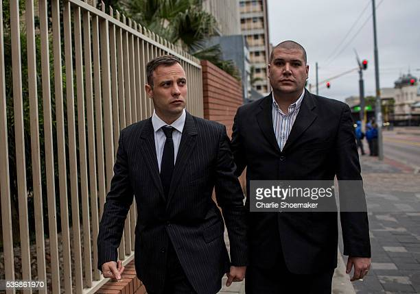 Oscar Pistorius makes his way back to the North Gauteng High Court after a lunch break on June 13, 2016 in Pretoria, South Africa. Having had his...