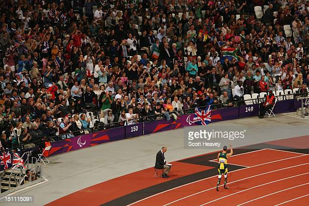 Oscar Pistorius of South Africa acknowledges the crowd after he broke the world record with a time of 2130 in the Men's 200m T44 heats on day 3 of...