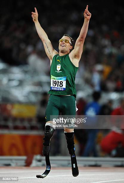 Oscar Pistorius of South Africa celebrates after winning the final of the men's 400 metre T44 classification event at the 2008 Beijing Paralympic...