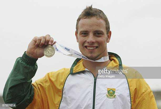 Oscar Pistorius of South Africa celebrates winning his second gold medal during the VISA Paralympic World Cup Athletics at the Sport City Stadium on...