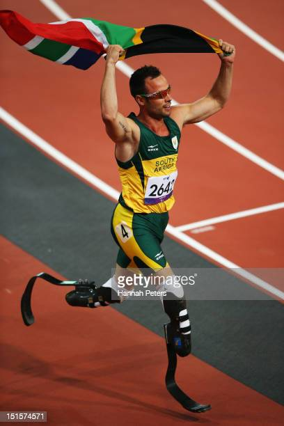 Oscar Pistorius of South Africa celebrates winning the Men's 400m ¿ T44 final on day 10 of the London 2012 Paralympic Games at Olympic Stadium on...