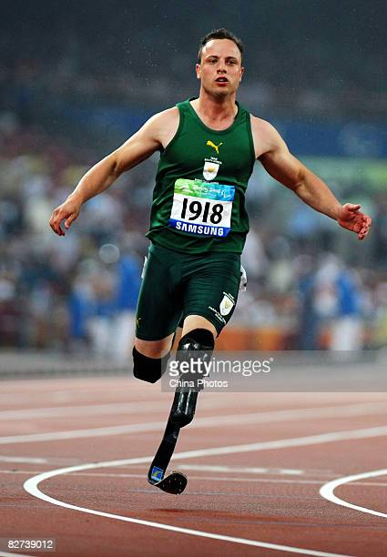 Oscar Pistorius of South Africa competes in the Men's 100m T44 Final Athletics event at the National Stadium during day three of the 2008 Paralympic...