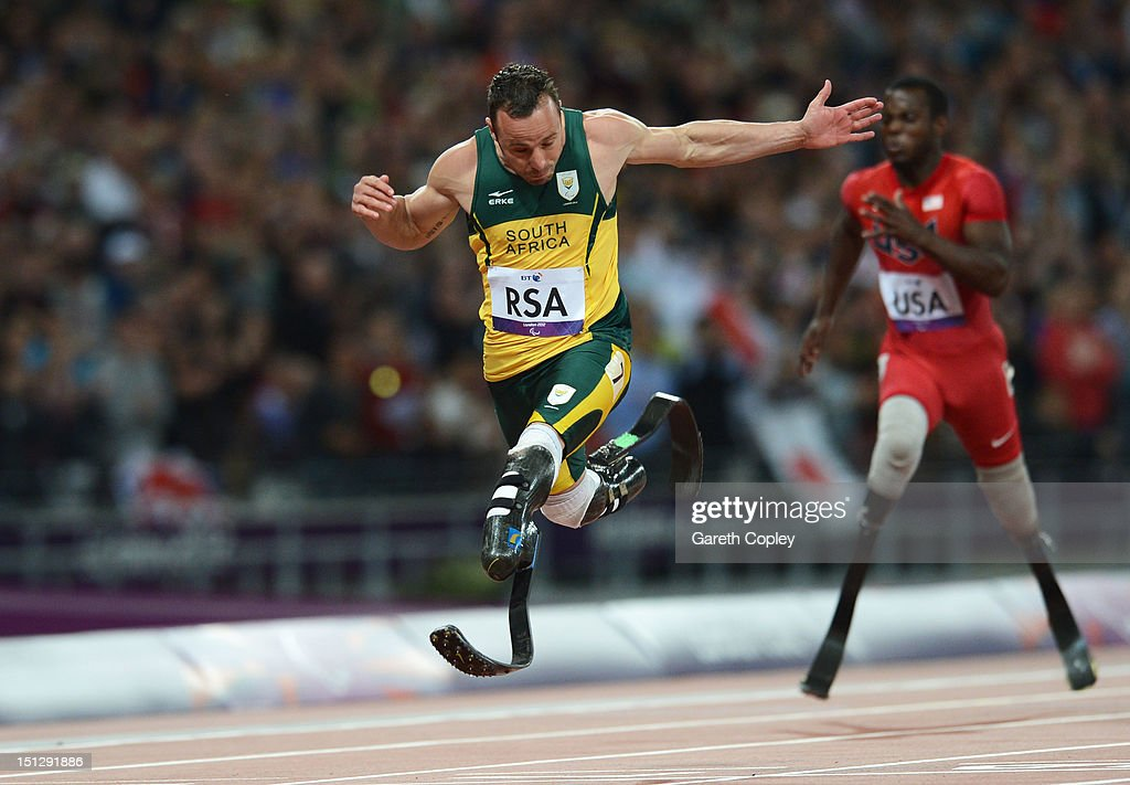 Oscar Pistorius of South Africa crosses the line to win gold for this team in the Men's 4x100m relay T42/T46 Final on day 7 of the London 2012 Paralympic Games at Olympic Stadium on September 5, 2012 in London, England.
