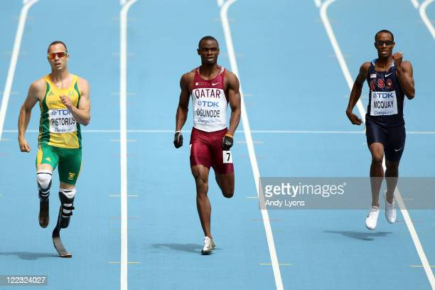 Oscar Pistorius of South Africa, Femi Ogunode of Qatar and Tony McQuay of United States compete in the men's 400 metres heats during day two of the...