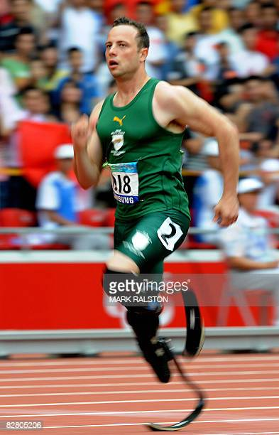 Oscar Pistorius of South Africa runs before finishing fastest in the heats of the men's 200 metre T44 classification event at the 2008 Beijing...