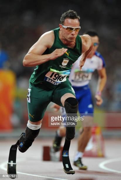 Oscar Pistorius of South Africa runs on his way to winning the final of the men's 400 metre T44 classification event at the 2008 Beijing Paralympic...