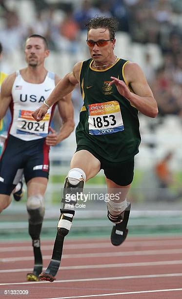 Oscar Pistorius of South Africa wins the 200m T44 for Men during the Athens 2004 Paralympic Games on September 212 004 at the Olympic Stadium in...