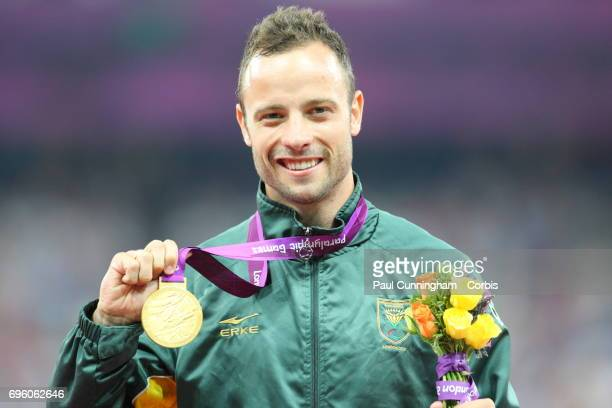 Oscar Pistorius poses with his gold medal during the Victory Ceremony of the Men's 400m T44 race during day 10 of the London 2012 Paralympic Games at...