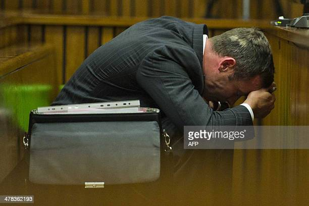 Oscar Pistorius reacts during his murder trial at the North Gauteng High Court in Pretoria on March 13 2014 The Paralympian pleaded not guilty to...