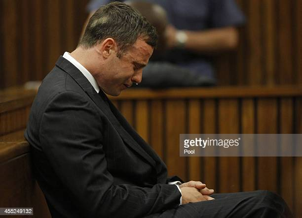 Oscar Pistorius reacts in the Pretoria High Court on September 11 in Pretoria South Africa South African Judge Thokosile Masipa has ruled out murder...