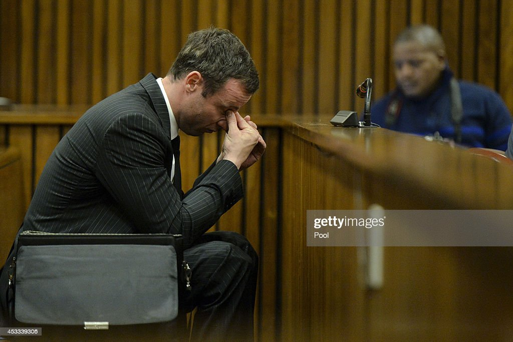 Oscar Pistorius sits in the dock during closing arguments in his murder trial in the Pretoria High Court on August 8, 2014, in Pretoria, South Africa. Oscar Pistorius stands accused of the murder of his girlfriend, Reeva Steenkamp, on February 14, 2013. This is Pistorius' official trial, the result of which will determine the paralympian athlete's fate.