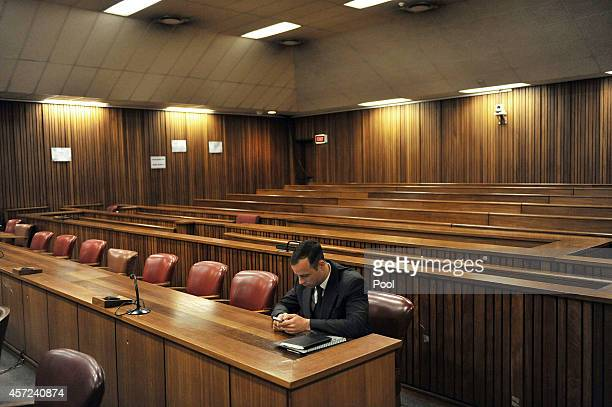 Oscar Pistorius sits in the Pretoria High Court on October 15 in Pretoria, South Africa. Judge Thokozile Masipa found Pistorius not guilty of...
