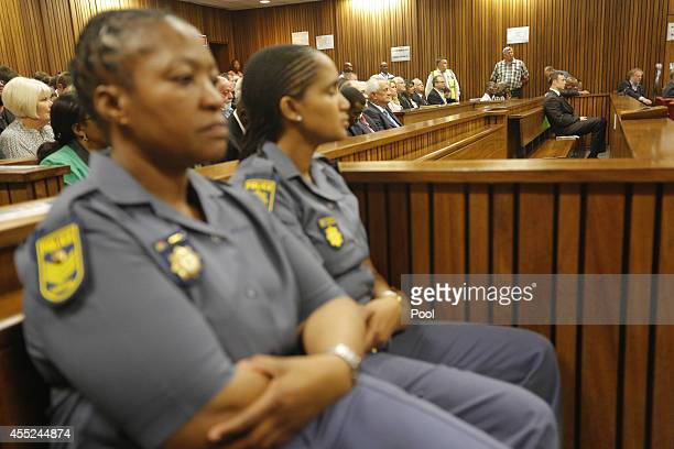 Oscar Pistorius sits in the Pretoria High Court on September 11 in Pretoria, South Africa. South African Judge Thokosile Masipa is due to give her...