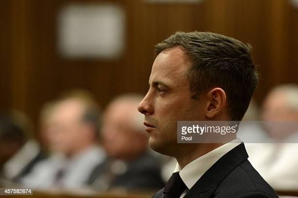 Oscar Pistorius stands as he listens to his judgement in the Pretoria High Court on October 21 in Pretoria South Africa Judge Thokozile Masipa handed...