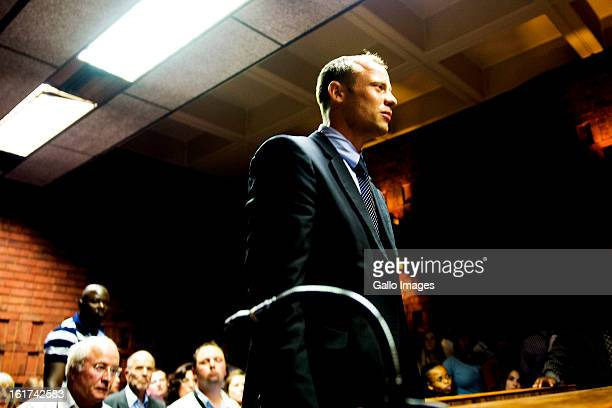 Oscar Pistorius stands for the charges during the Pretoria Magistrate court hearing on February 15 in Pretoria, South Africa. Oscar Pistorius stands...