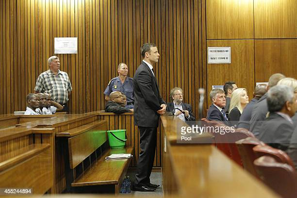 Oscar Pistorius stands in the Pretoria High Court on September 11 in Pretoria, South Africa. South African Judge Thokosile Masipa is due to give her...