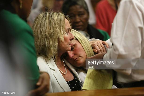 Oscar Pistorius takes his seat during his trial at the Pretoria High Court on September 12 in Pretoria, South Africa. South African Judge Thokosile...