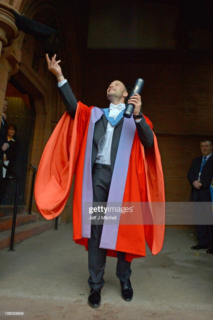 Oscar Pistorius, throws his hat after receiveing his honorary doctorate from Strathclyde University in the Barony Hall on November 12, 2012 in Glasgow, United Kingdom. The athlete was made a Doctor of the University after competing at both the Olympic and Paralympic Games, where he won two gold medals and a silver medal. Oscar became the first paralympian to win a medal at an able bodied championship at the 2011 World Athletics Championships. He went on to compete at the London 2012 Olympic Games where he ran in the 400m and the relay earlier this year.