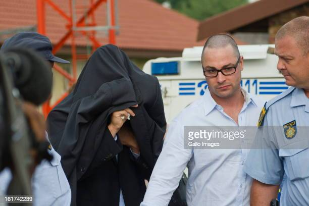 Oscar Pistorius with his brother Carl Pistorius attends the Pretoria Magistrate court on February 15 in Pretoria South Africa Oscar Pistorius stands...
