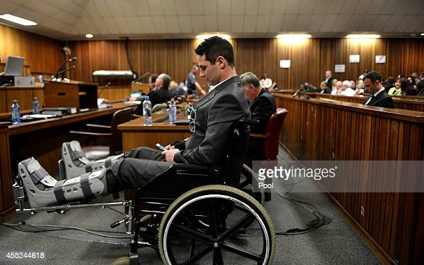 Oscar Pistorius's brother Carl Pistorius sits in the Pretoria High Court on September 11 in Pretoria, South Africa. South African Judge Thokosile...
