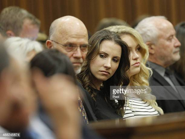 Oscar Pistorius's family sit in the Pretoria High Court on September 11 in Pretoria, South Africa. South African Judge Thokosile Masipa is due to...