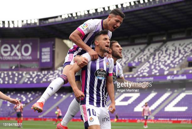 Oscar Plano of Real Valladolid celebrates with team mates after scoring their side's first goal during the La Liga Santander match between Real...