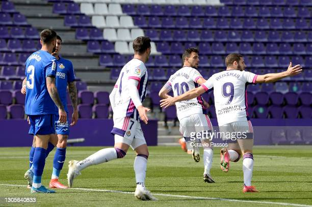 Oscar Plano of Real Valladolid celebrates with teammate Shon Weissman after scoring his team's first goal during the La Liga Santander match between...